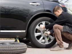 Man changing his spare wheel